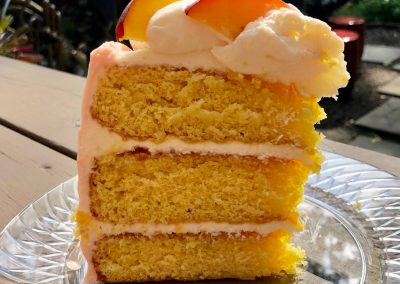peach cream cloud cake slice